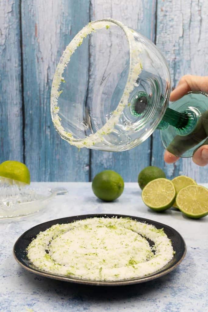 Margarita glass with lime zest salt rim.