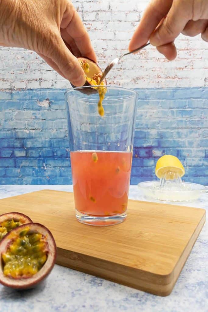 Adding passion fruit pulp into a cocktail shaker