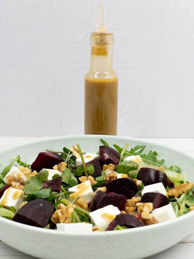 Delicious balsamic vinegar dressing and a bowl of beetroot salad with feta waiting to be eaten