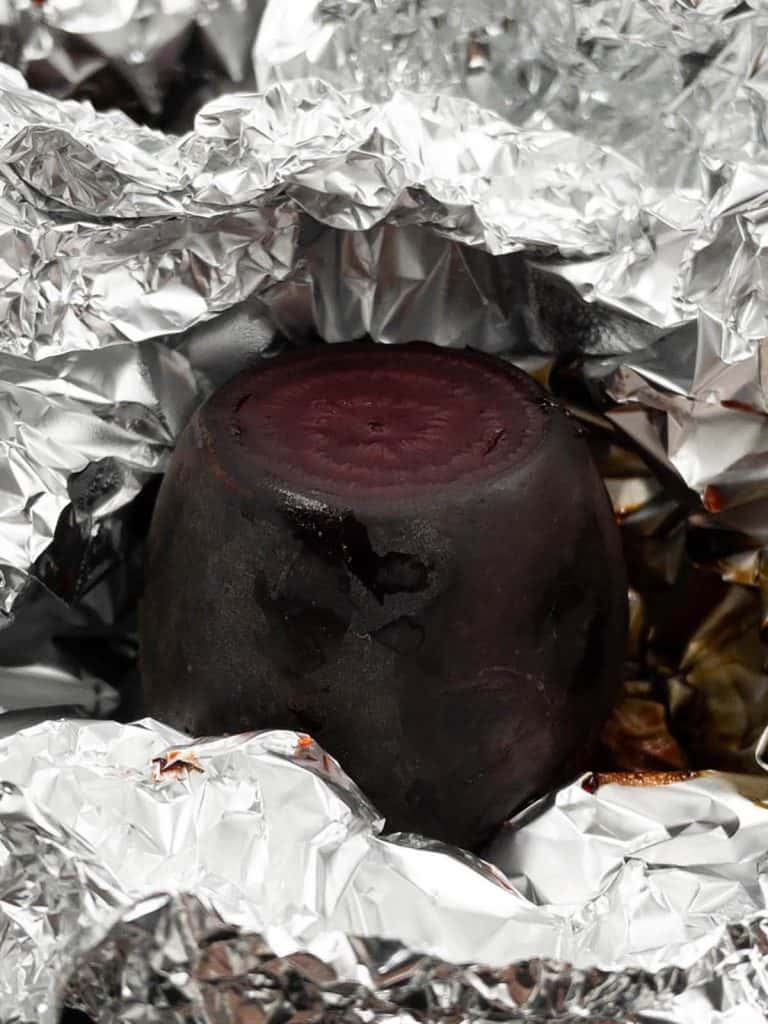 Freshly roasted beetroot straight out of the oven still in its tin foil