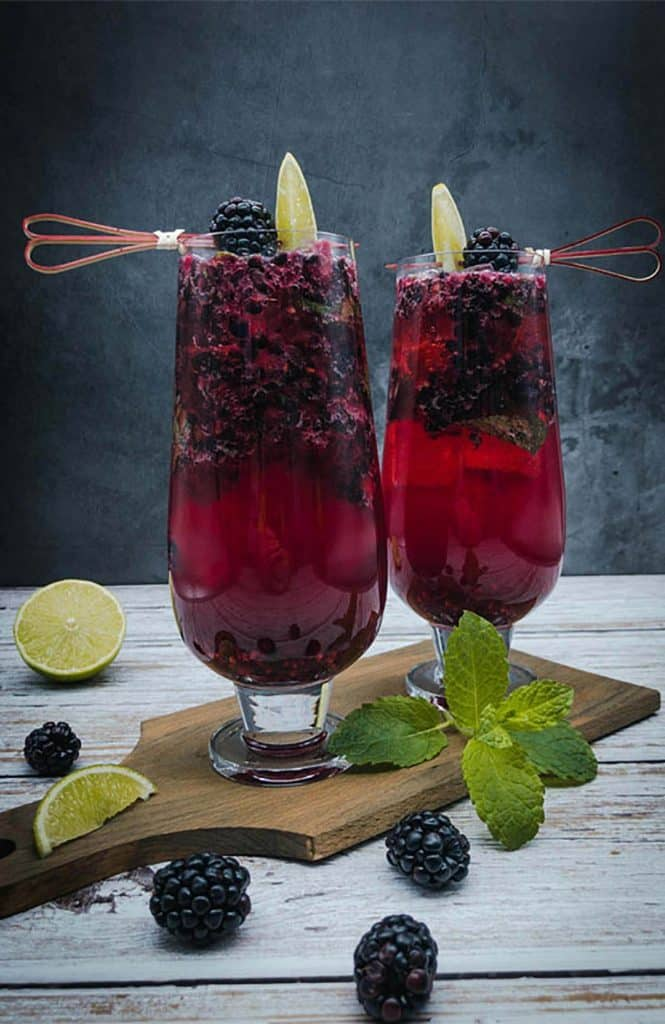 Blackberry mojito cocktails on a wooden board