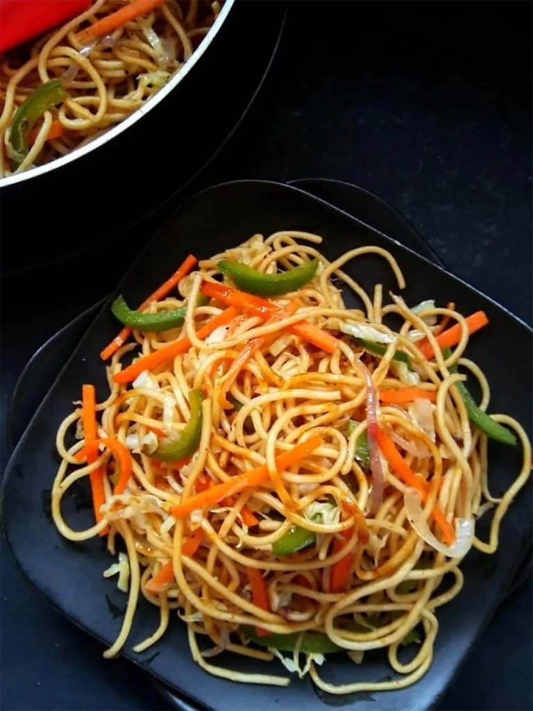 Vegetable chow mein with peppers, sauce and noodles, one of our perfect lazy vegan recipes.
