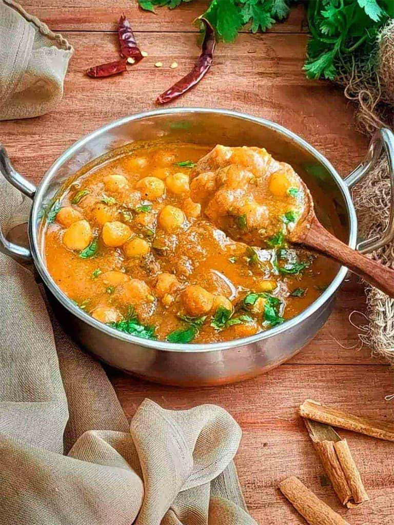 Tasty spoonful of chana masala.