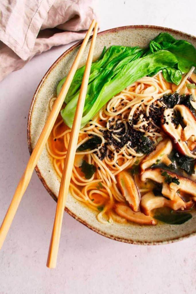 Miso ramen with shitake mushrooms, black sesame seeds, bok choy and soy sauce.