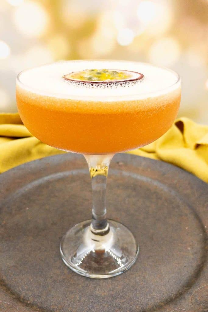 Two delicious pornstar martini cocktails, passion fruits and shots of sparkling wine