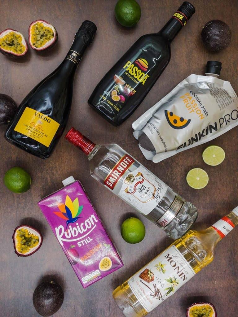 Ingredients for pornstar martini Vodka passoa, chilled prosecco sparkling wine, passion fruit puree, passion fruit juice and passion fruits and limes