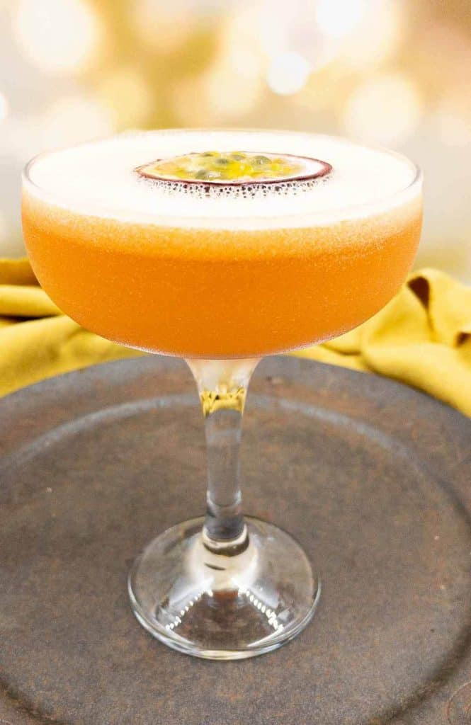 Homemade pornstar martini with a floating passion fruit and a shot of prosecco