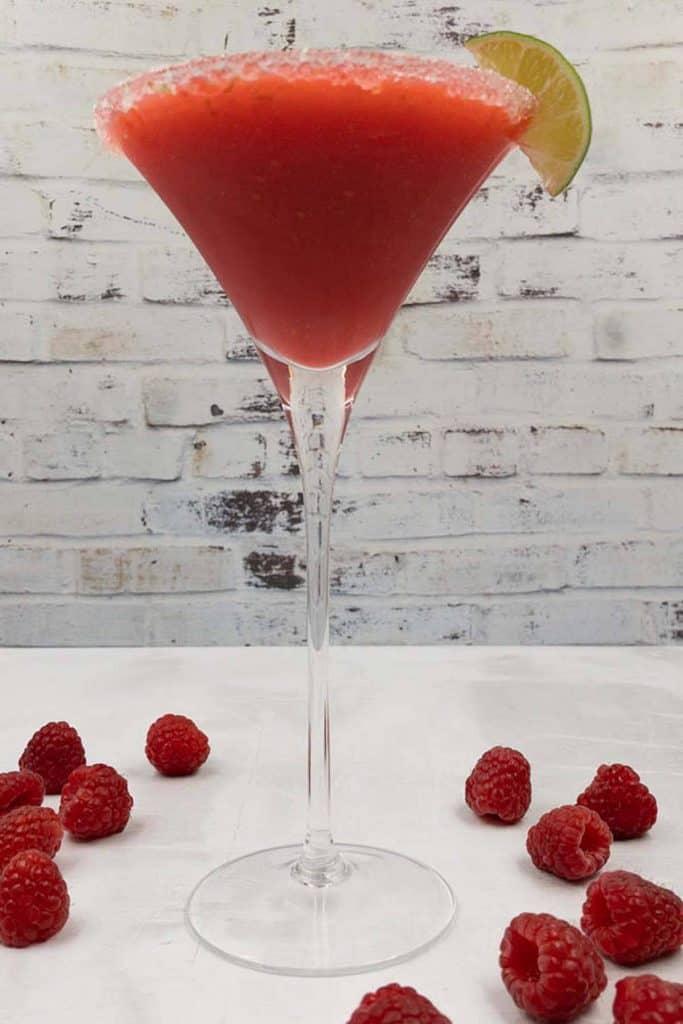 Refreshing raspberry daiquiri drink with fresh raspberries.