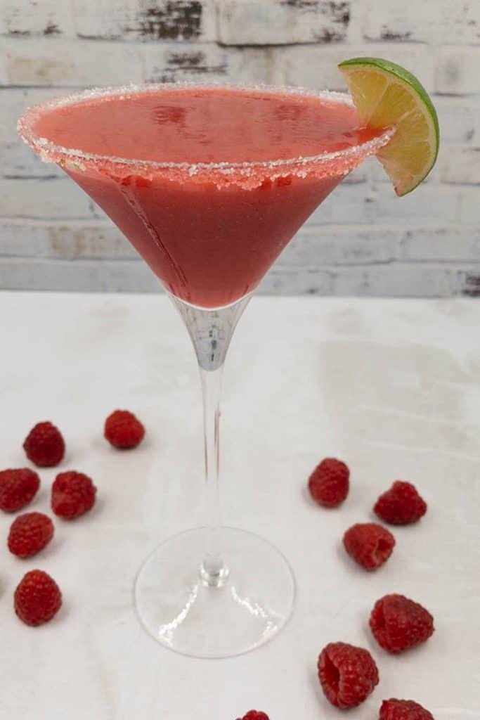 A refreshing fruity homemade raspberry daiquiri with fresh raspberries.