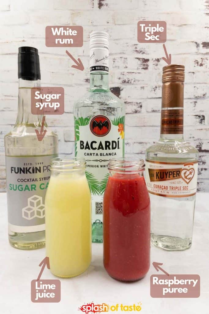 Ingredients needed to make a raspberry daiquiri, white rum, lime juice, sugar syrup, triple sec and raspberry puree.