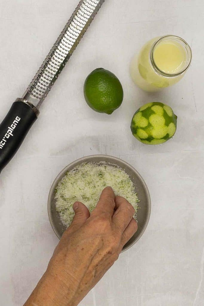 Mixing a lime sugar mixture for a sugar rim.