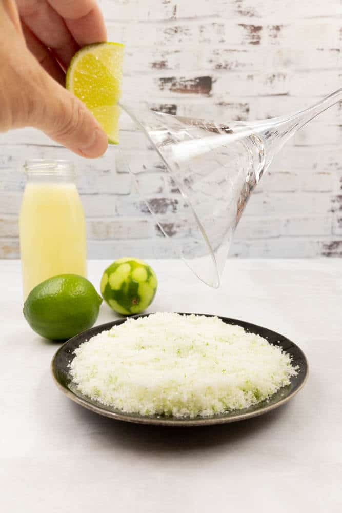 Wiping a rim with fresh lime.