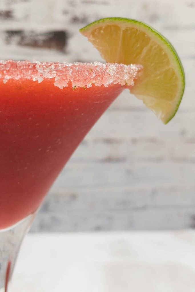 Side view of smooth fruity strawberry daiquiri drink.