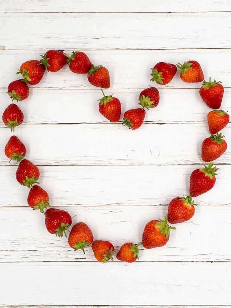 A heart shape made from strawberries.