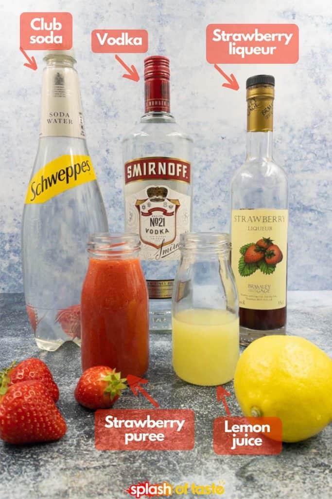 Ingredients for strawberry lemonade vodka drinks, club soda, vodka, strawberry liqueur, strawberry puree and freshly squeezed lemon juice.