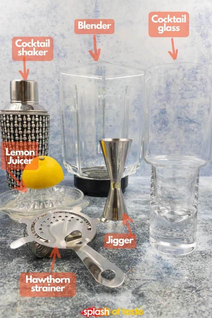 Equipment needed for vodka strawberry lemonade drinks, shaker, blender, glass, jigger, fresh lemon juicer and Hawthorne strainer.