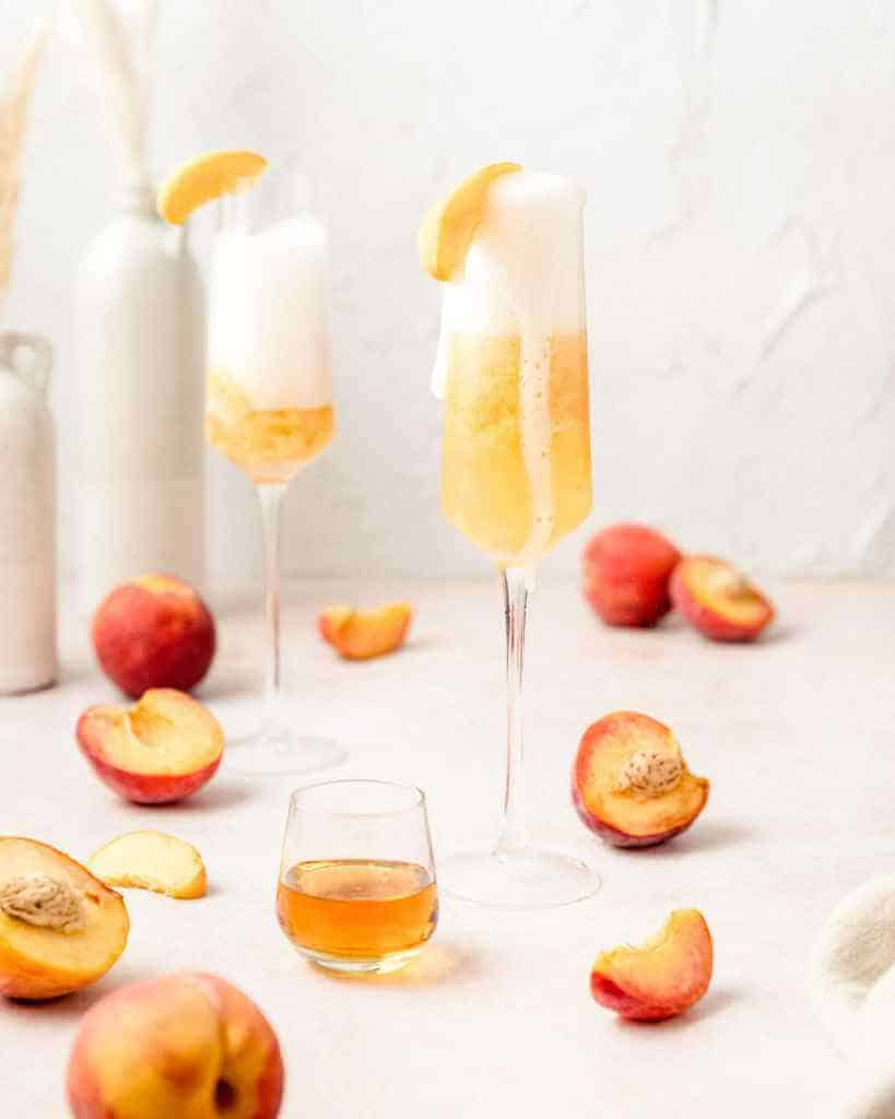 Two peach bellini cocktails made with three ingredients