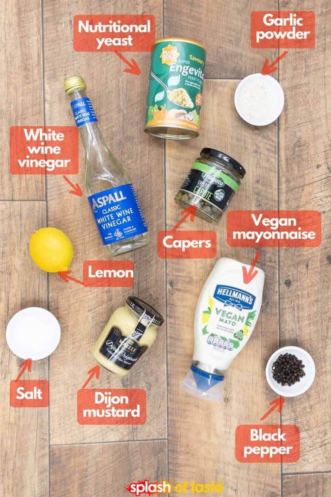 Ingredients to for a homemade vegan caesar dressing recipe, nutritional yeast, garlic powder, capers, vegan mayo, black pepper, Dijon mustard, salt, fresh lemon and white wine vinegar.