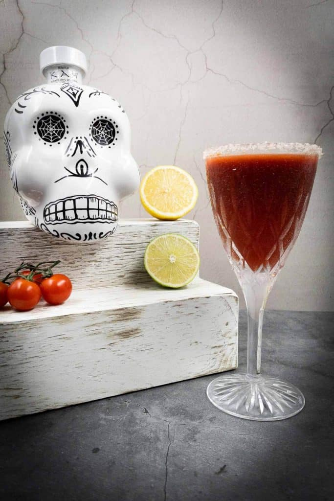 A Calaveras used in the Day of the Dead and a glass of cocktail from the crypt Halloween drink.