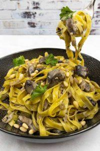 Homemade mushroom pasta with garlic butter in a mushroom sauce.
