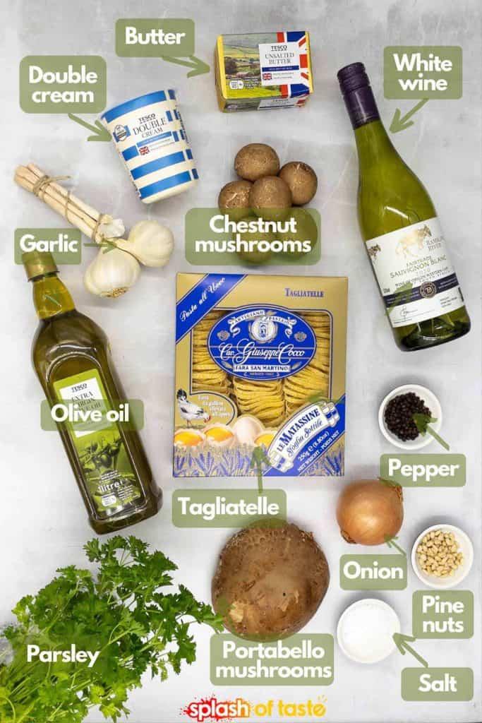Ingredients for a recipe to make mushroom pasta, double cream, butter, white wine, chestnut mushrooms, garlic, olive oil, tagliatelle, onion, pine nuts, salt, pepper, portabella mushroom and fresh parsley.