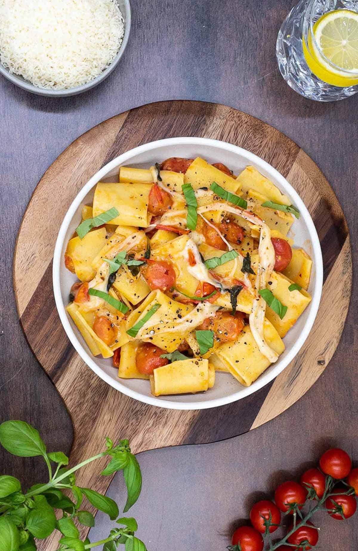 A homemade bowl of pasta alla sorrentina on a board.