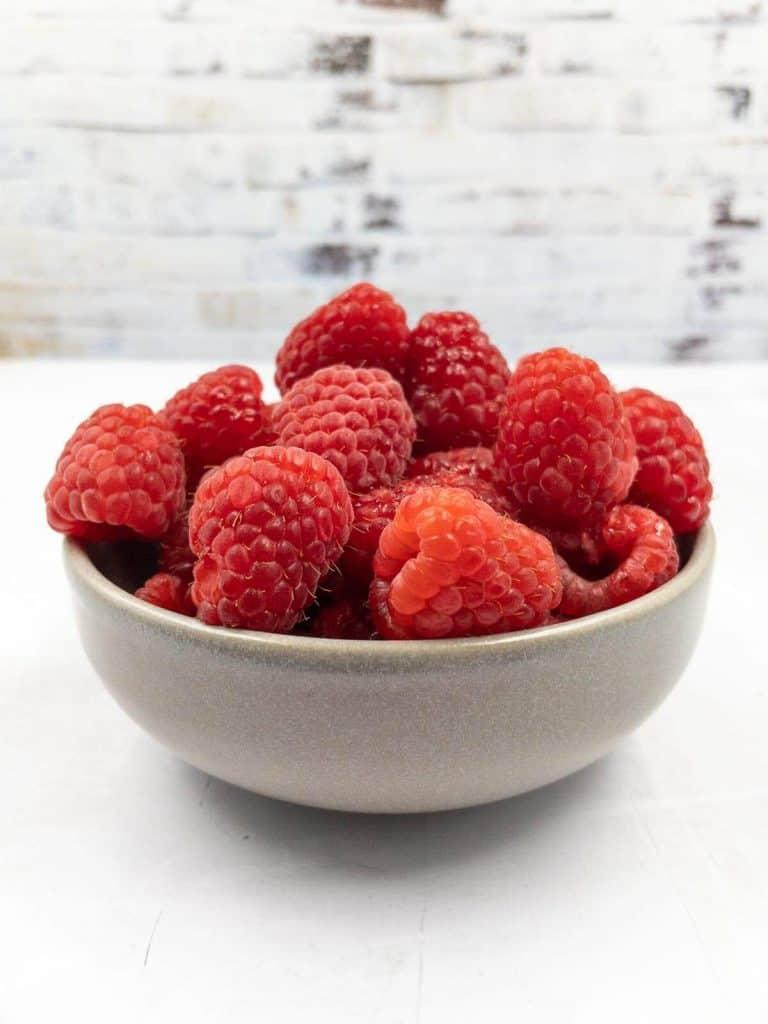 A bowl of fresh raspberries.