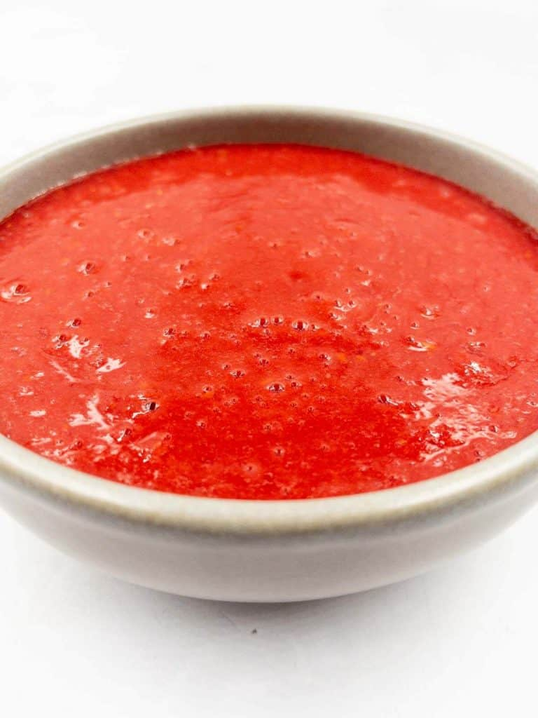 Fresh bubbly pureed raspberries.