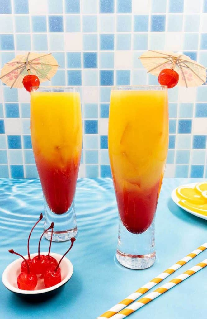 Two tequila sunrise cocktails.
