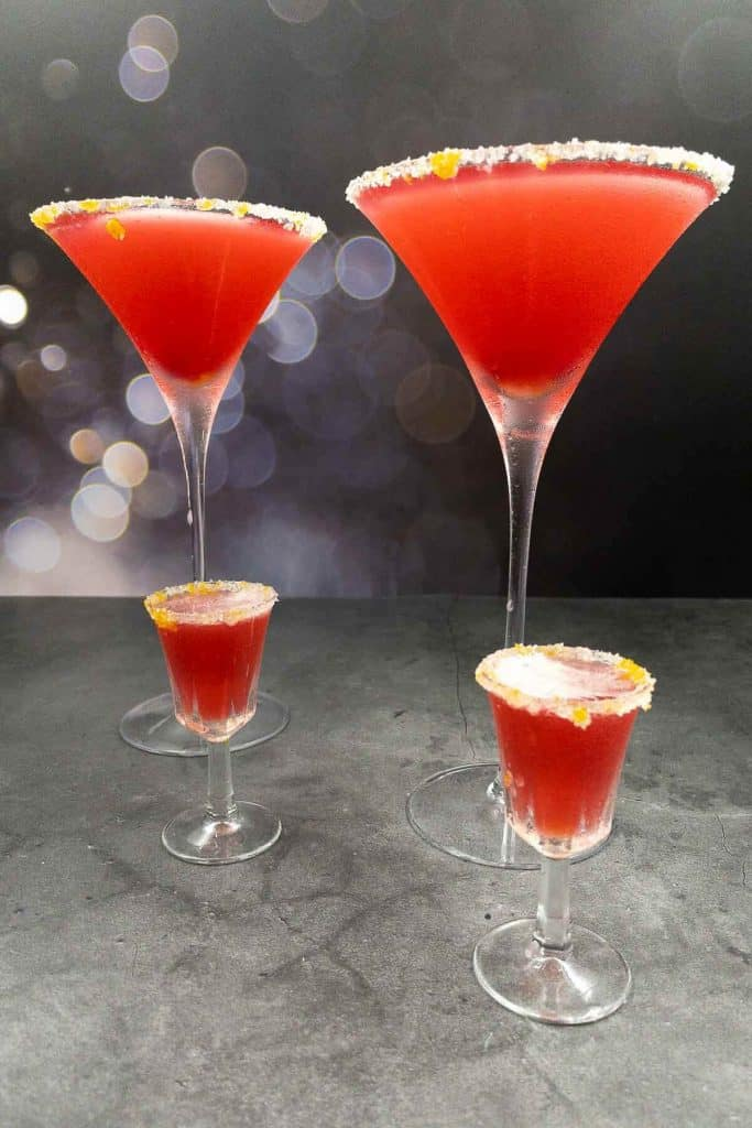Four cranberry margaritas, freshly made cranberry cocktail ready to drink.
