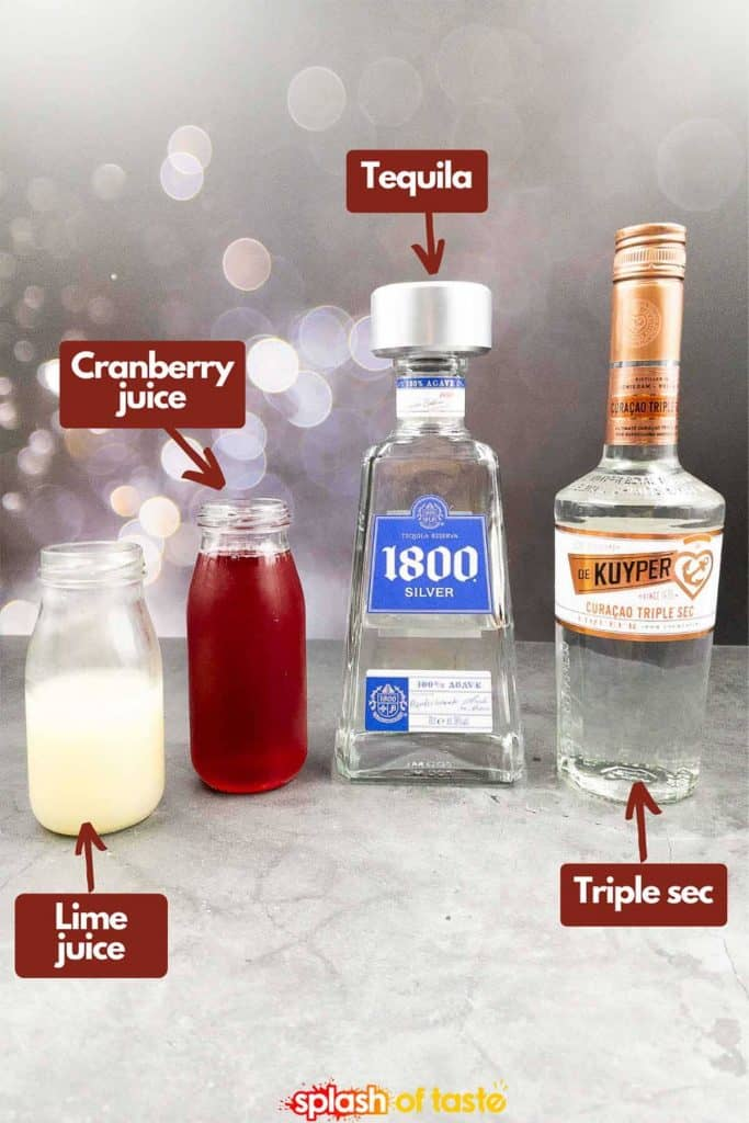 Ingredients to make a cranberry margarita recipe, fresh lime juice, cranberry juice, tequila and triple sec.