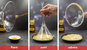 Process shot for making salt sugar rim, paint rim with honey, swirl in salt, sugar and orange zest and admire.
