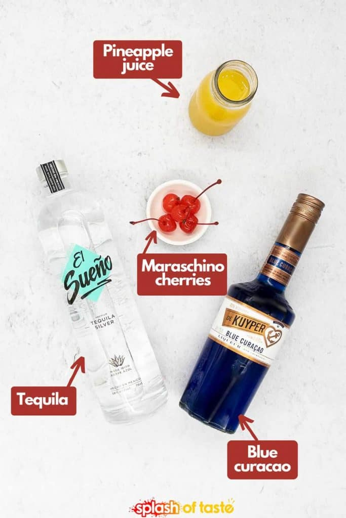 Ingredients to make an Envy blue drink, pineapple juice, maraschino cherries, blue curaçao and tequila.