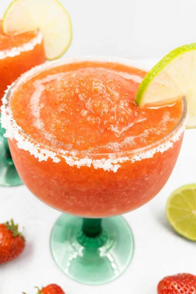 Delicious homemade frozen strawberry margaritas fresh and ready to serve immediately.