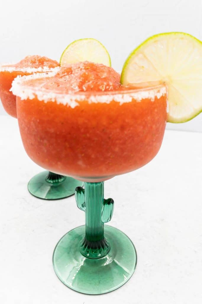 Two frozen strawberry margaritas ready to drink all summer long.