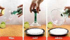 Process shot for making margarita salted rim, wipe with fresh lime juice from wedge, swirl in salt and admire.