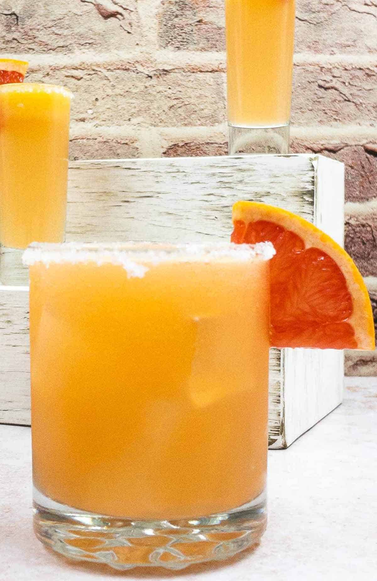 Paloma cocktail with fresh slice of grapefruit.