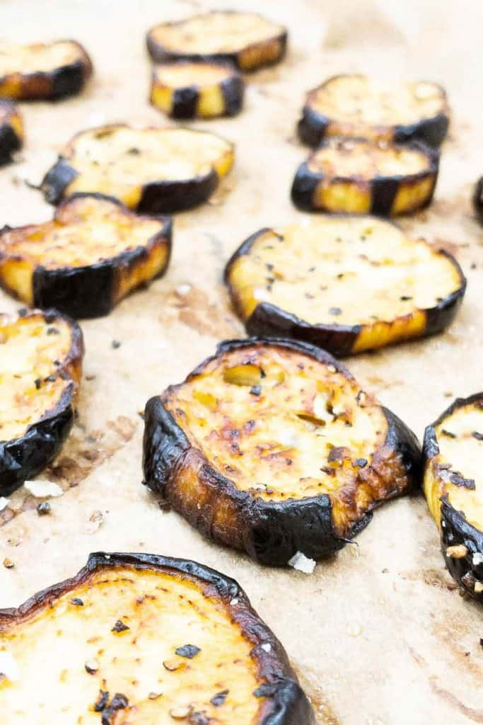 Slices of freshly roasted eggplant, seasoned with red pepper flakes.