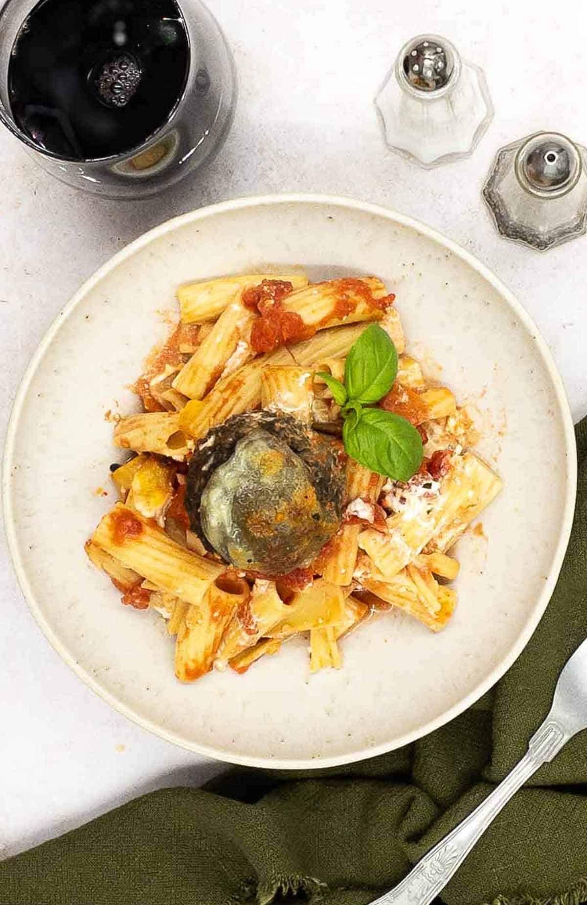 Veggie pasta bake with meatballs and rigatoni pasta.