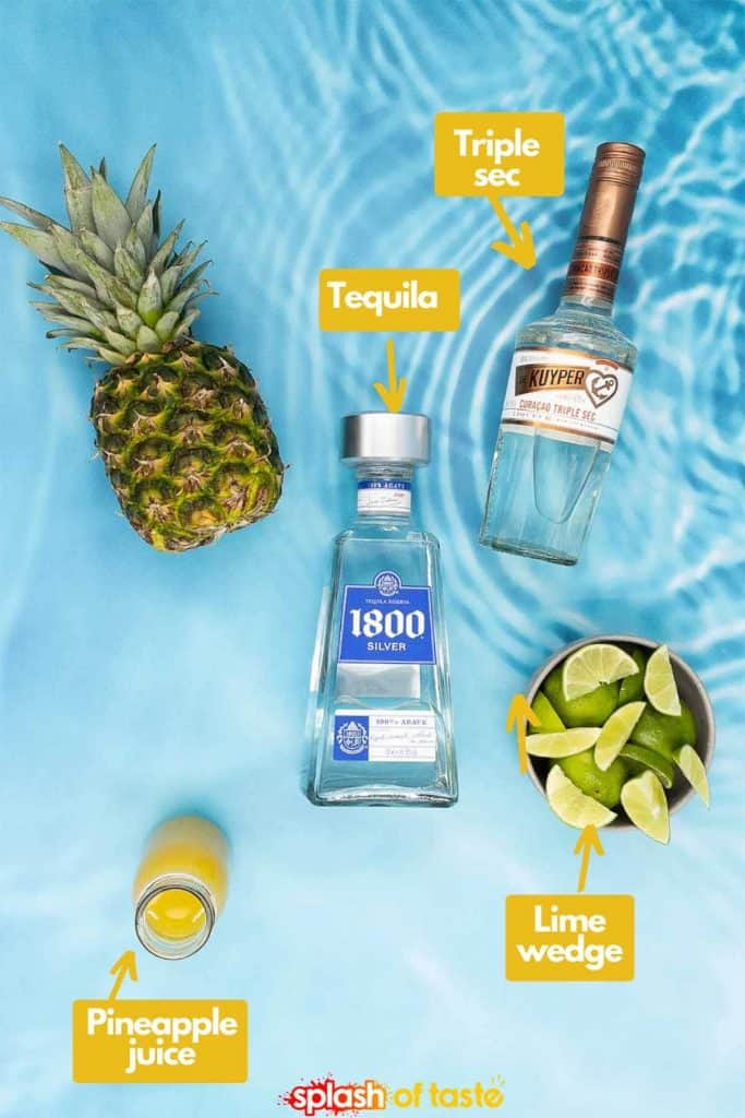 Ingredients for a homemade pineapple tequila, pineapple, tequila, orange liqueur, lime wedges and fresh pineapple juice.