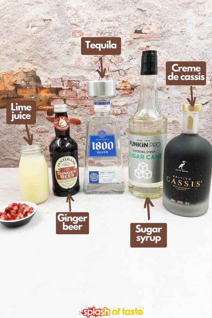 Ingredients for making a tequila diablo rojo, lime juice, ginger beer, tequila, sugar syrup and creme de cassis.