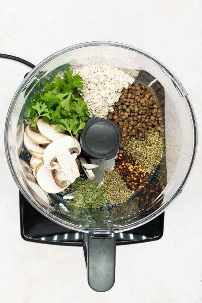 Ingredients for vegetarian meatballs in a food processor.