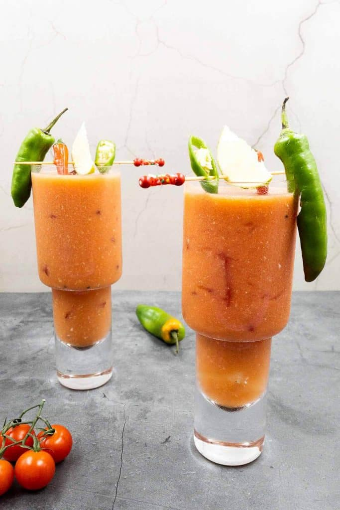 Two Bloody Maria cocktails in glasses.