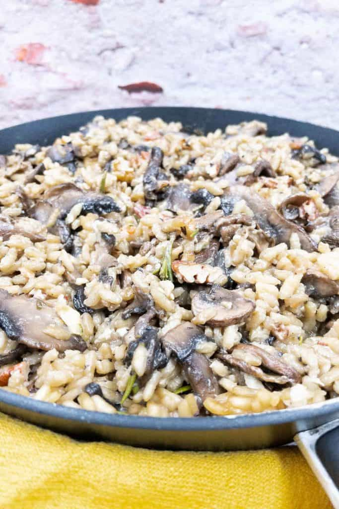 Freshly made mushroom risotto in a pan.